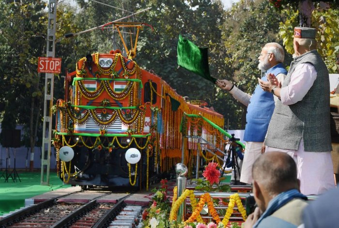 Prime Minister Narendra Modi flags off an elctric locomotive converted from a diesel engine at Diesel Locomotive Works (DLW), in Varanasi on Feb. 19, 2019. (PIB/PTI Photo)