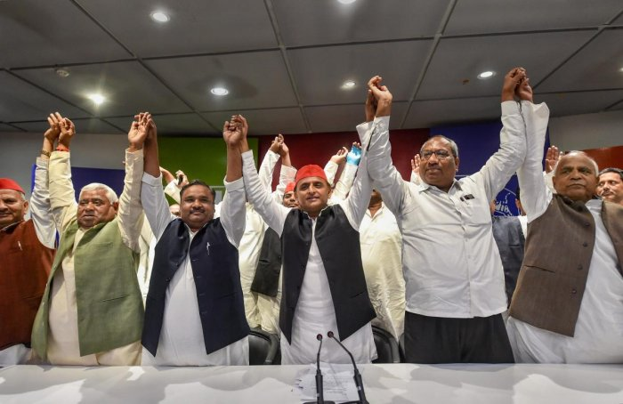 Samajwadi Party President Akhilesh Yadav, Nishad Party President Sanjay Nishad and Janwadi Party (Socialist) President Sanjay Singh Chauhan during a joint press conference at the party office, in Lucknow, Tuesday, March 26, 2019. (PTI Photo)