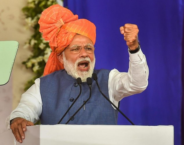 Prime Minister Narendra Modi addresses during the launch of 'Pradhan Mantri Shram Yogi Pension Yojana' (PM-SYM Scheme 2019) for unorganised workers, in Ahmedabad on Tuesday. (PTI Photo)