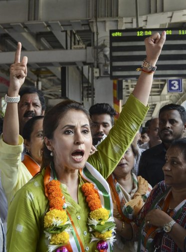 Bollywood actress and Congress candidate Urmila Matondkar campaigns for the Lok Sabha polls at Borivali Station, in Mumbai, Monday, April 15, 2019. PTI Photo
