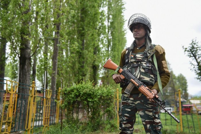 A security personnel stands guard outside an EVM distribution centre ahead of the second phase of Lok Sabha elections, in Srinagar, Wednesday, April 17, 2019. (PTI Photo)