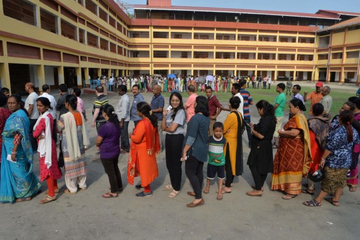 Voters queue up to cast their vote at a polling station in Siliguri, West Bengal on April 18, 2019, during the second phase of Lok Sabha elections. (AFP Photo)