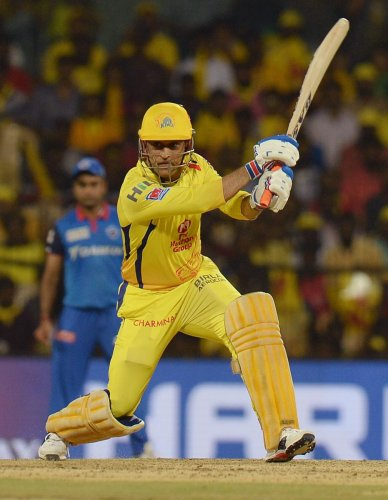 Chennai Super Kings' Mahendra Singh Dhoni will look to end the league stage on a high when they take on Kings XI Punjab. AFP