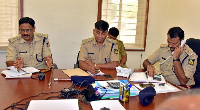 DCP (Law and order) Hanumantaraya interacts with a caller during the weekly phone-in programme, in the office of Mangaluru City Police Commissionerate on Friday.