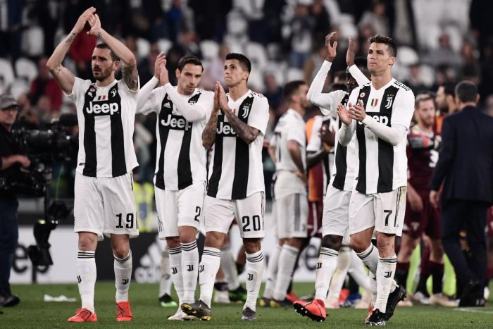 Juventus' Portuguese forward Cristiano Ronaldo (R) reacts at the end of the Italian Serie A football match Juventus vs Torino. AFP
