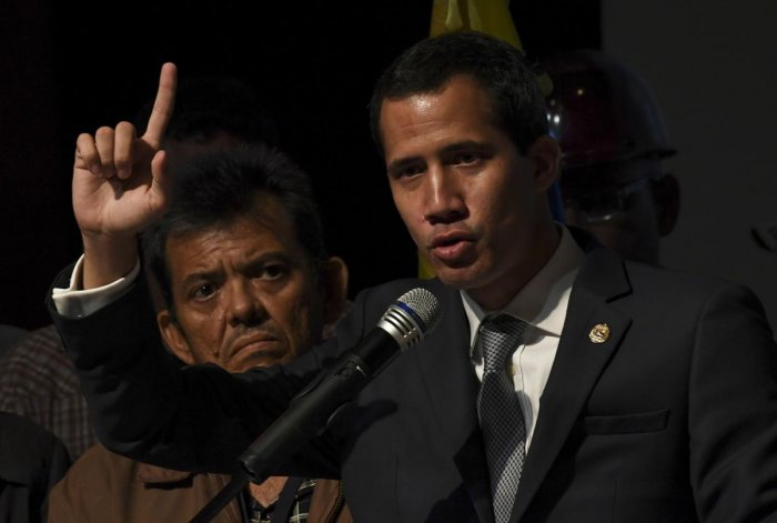 Venezuelan opposition leader and self-proclaimed acting president Juan Guaido speaks during a meeting with a group of workers of the state oil company of Venezuela. AFP