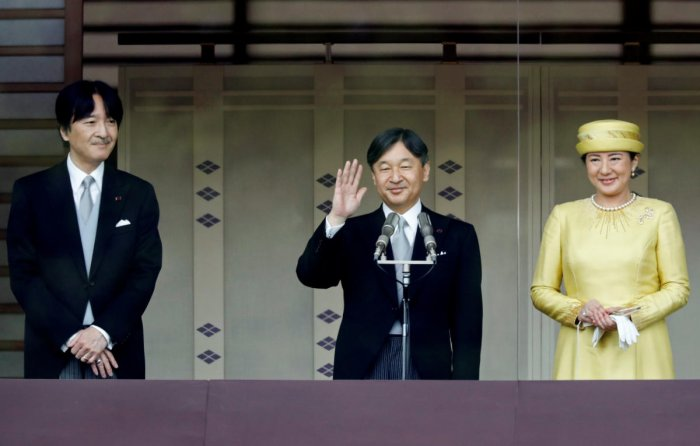 Japan's Crown Prince Akishino looks on as Emperor Naruhito and Empress Masako greet well-wishers during their first public appearance at the Imperial Palace in Tokyo. Reuters
