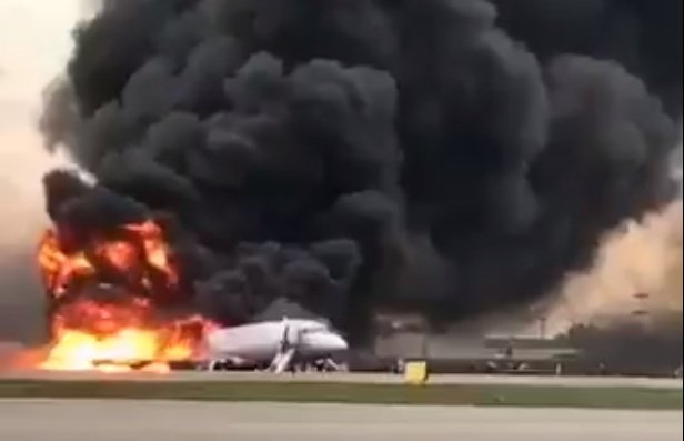 Russian television showed huge black columns of smoke towering over the plane. (Video grab)
