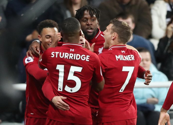 Never back down: Liverpool's Divock Origi (second from right) celebrates with team-mates after scoring the winner against Newcastle United on Saturday. REUTERS
