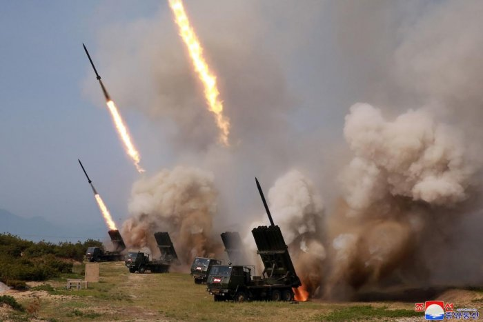 """North Korea has tested long-range multiple rocket launchers and tactical guided weapons in a """"strike drill"""" overseen by leader Kim Jong Un, state media said. AFP Photo"""