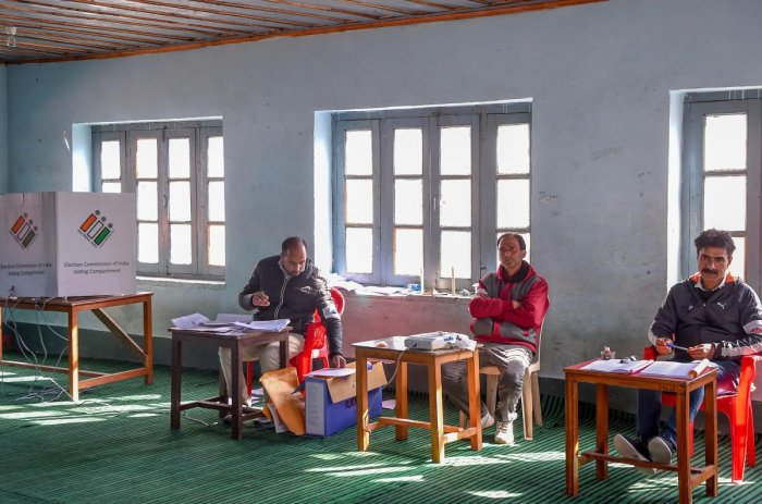 Poll officials at a polling station during the fifth phase of Lok Sabha elections, in Pulwama district. PTI photo