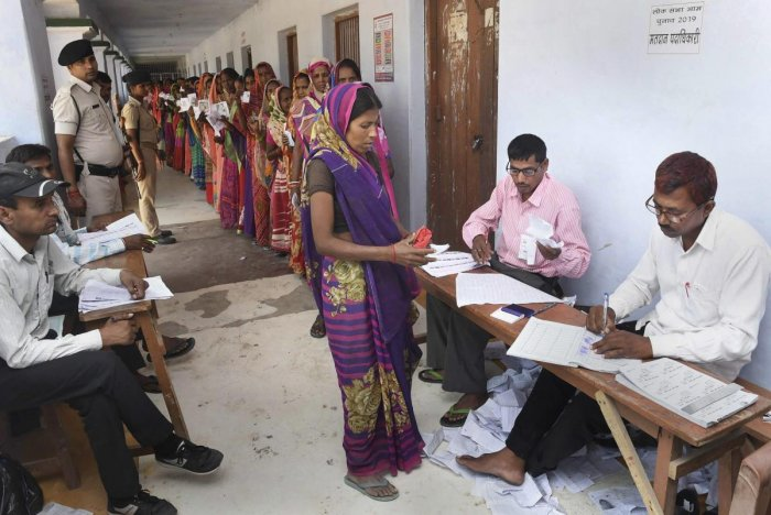 Women voters stand in a long queue at a polling station, during the 5th phase of Lok Sabha polls, in Chhapra district of Bihar, Monday May 6, 2019. (PTI Photo)