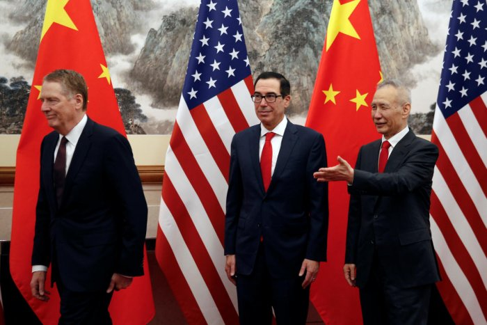 Chinese Vice Premier Liu He, right, shows the way to U.S. Treasury Secretary Steven Mnuchin, center, and U.S. Trade Representative Robert Lighthizer, left, as they proceed to their meeting at the Diaoyutai State Guesthouse in Beijing. (Reuters File Photo)