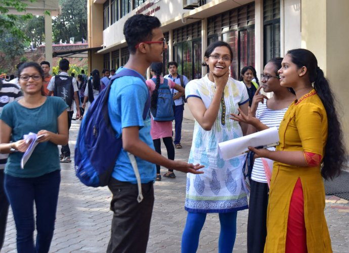 Students discuss among themselves after writing NEET examination at St Aloysius College in Mangaluru on Sunday.