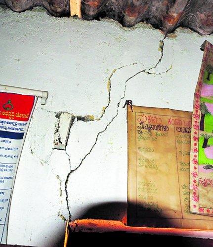 The cracked wall of the anganwadi centre at Abhyathmangala Paisari in Valnooru Tyagathooru Gram Panchayat jurisdiction in Kushalnagar.