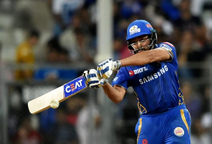 HIT MAN: Mumbai Indians captain Rohit Sharma hammers one to the fence during his unbeaten 55 against Kolkata Knight Riders in the IPL tie in Mumbai on Sunday. Mumbai won the match by nine wickets. PTI