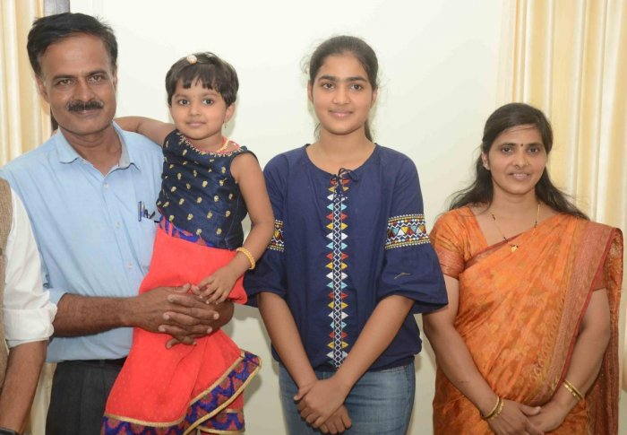 CBSE class X topper Girija with father Manjunath Hegde, mother Tunga and sister Pavani.