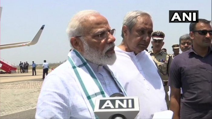 Modi with Odisha CM Naveen Patnaik after his survey. ANI/Twitter photo