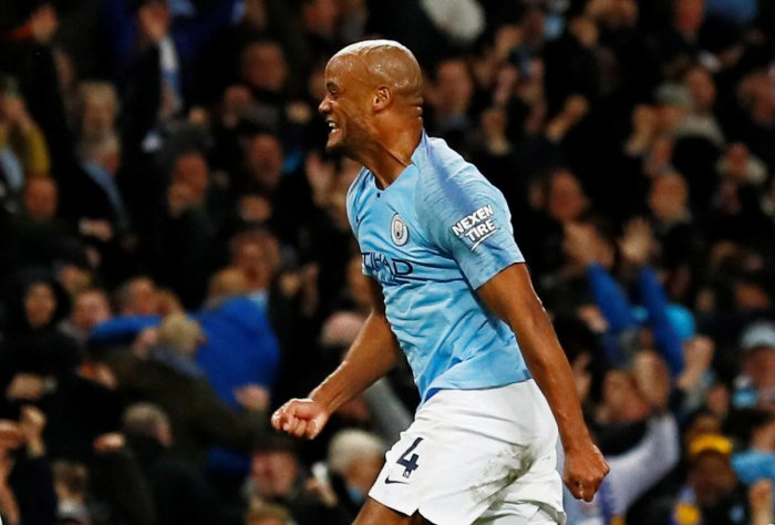 Manchester City captain Vincent Kompany (right) celebrates scoring the winner against Leicester City on Monday. AFP
