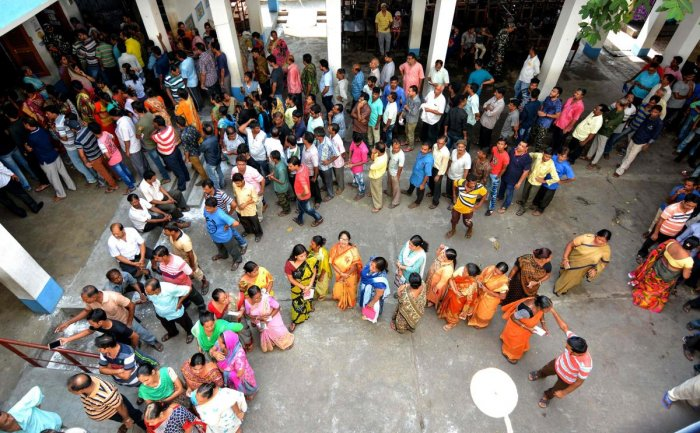 Voters queue at a polling station to cast their ballots during the fifth phase of General election in Howrah in West Bengal. AFP photo