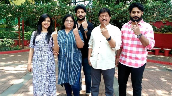Pranam Devaraj (centre) with family.