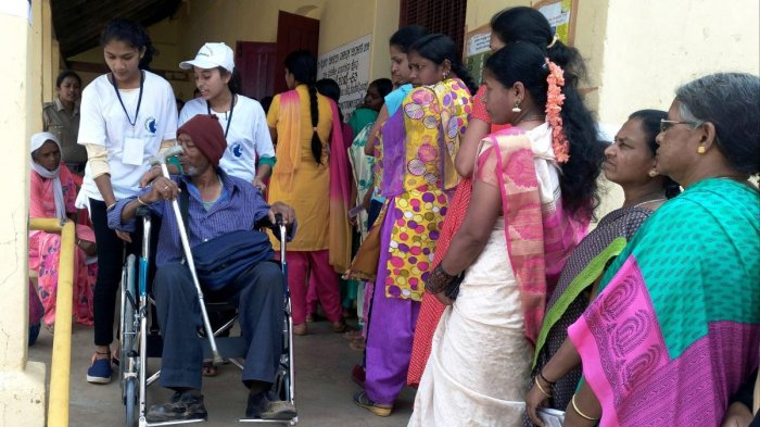 Venkatesh, a patient suffering from paralysis, exercised his franchise at the polling booth at the Government Junior College, Somwarpet.