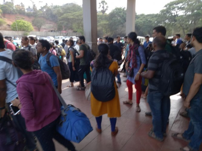 Passengers who arrived in the voter special train at Mangalore junction.