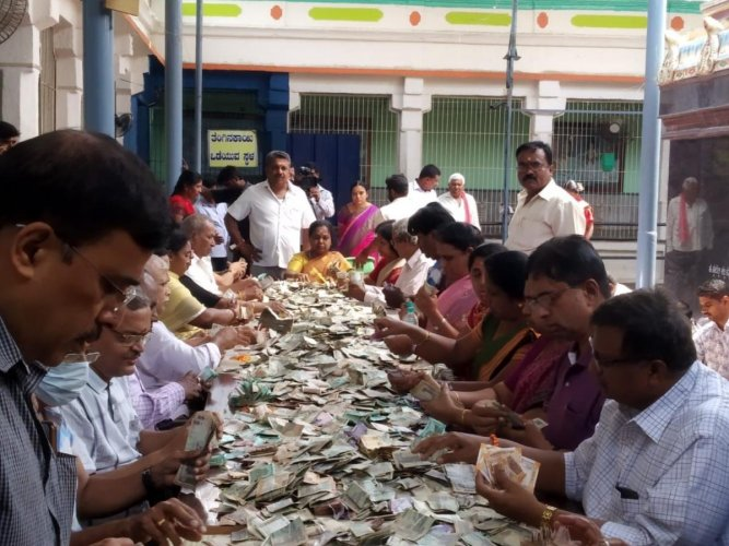 The authorities at the Ghati Subramanya Swamy Temple count the offerings from devotees.