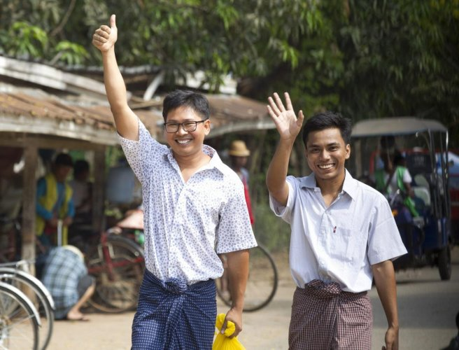 Reuters journalists Wa Lone, left, and Kyaw She Oo wave as they walk out from Insein Prison after being released in Yangon, Myanmar Tuesday, May 7, 2019. (AP/PTI)
