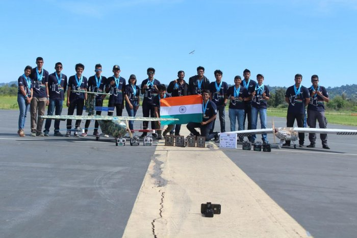 Few members of team Arcis posing with the aircrafts they built.