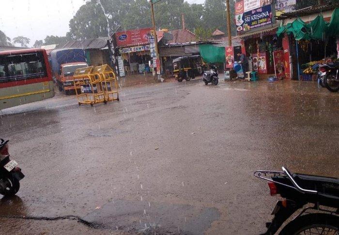 Naravi in Beltangady taluk of Dakhina Kannada district received copious rains. (Right) Suntikoppa in Kodagu district received rain on Tuesday evening. DH Photo
