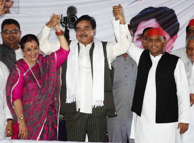 Samajwadi Party President Akhilesh Yadav with Party candidate from Lucknow Poonam Sinha and Congress candidate from Patna Sahib Shatrughan Sinha during an election campaign rally for the Lok Sabha elections, in Lucknow, Thursday, May 2, 2019. (PTI Photo)