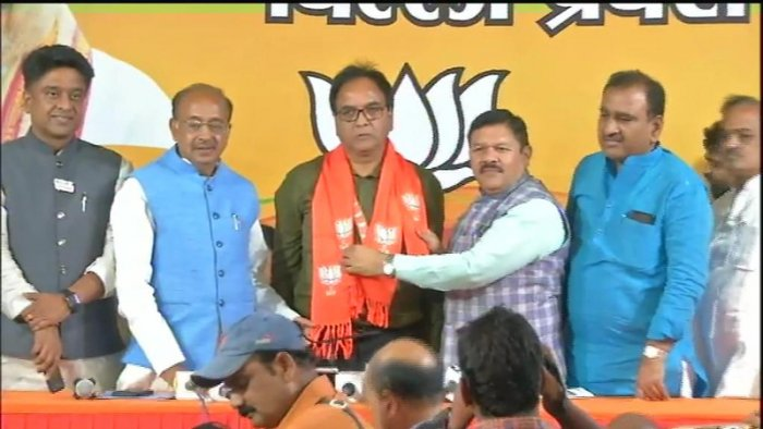 BJP leaders welcome Anil Bajpai to the party. (ANI/Twitter)