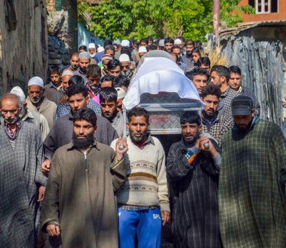 People carry the body of BJP state vice-president Ghulam Mohammad Mir during his funeral procession in Veerinag area of Anantnag district, J & K, Sunday, May 5, 2019., Mir was killed by the suspected militants. (PTI Photo)