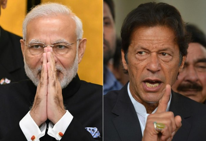 This combination of file pictures created on March 4, 2019 shows (L) India's Prime Minister Narendra Modi on an official visit to Tokyo on October 29, 2018, and Pakistan's Imran Khan, chief of the Pakistan Tehreek-i-Insaf (PTI) political party