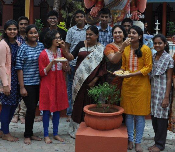 Students and teachers celebrate the CBSE class 10 results at Sai Angels School at Siragapura in Chikkamagaluru.