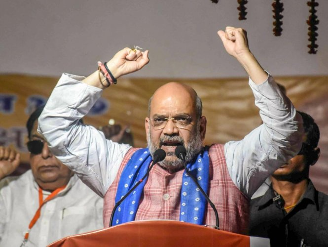 BJP president Amit Shah on Wednesday claimed that this Lok Sabha election is a fight between '3 Gs' of the Congress represented by the Gandhi family and those of the saffron party exemplified by gaon, goumata and the Ganga. PTI file photo