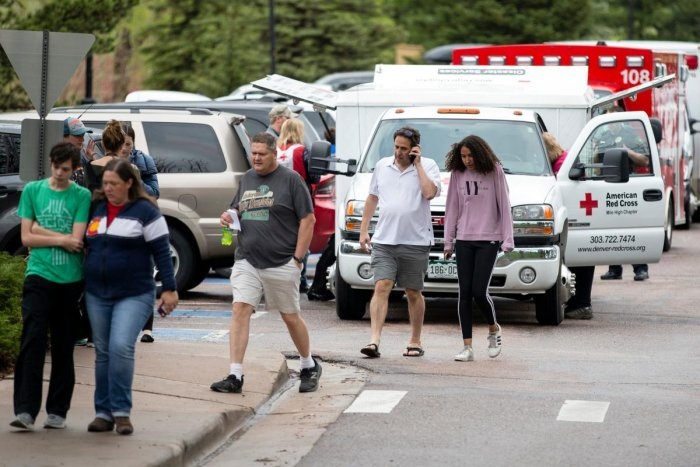 Parents pick up their children from the Recreation Center at Northridge in Highlands Ranch after a shooting at the STEM School Highlands Ranch, Colorado on May 7, 2019. - At least seven students were wounded on May 7 in a school shooting in the US state o