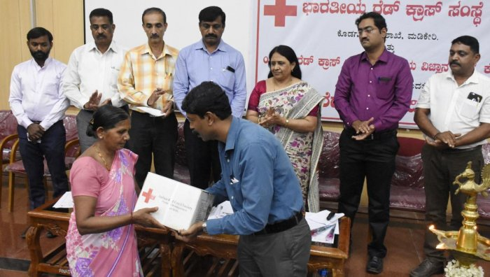Kits were given to the victims of natural calamity by IRCS Kodagu, in Madikeri, on Wednesday.