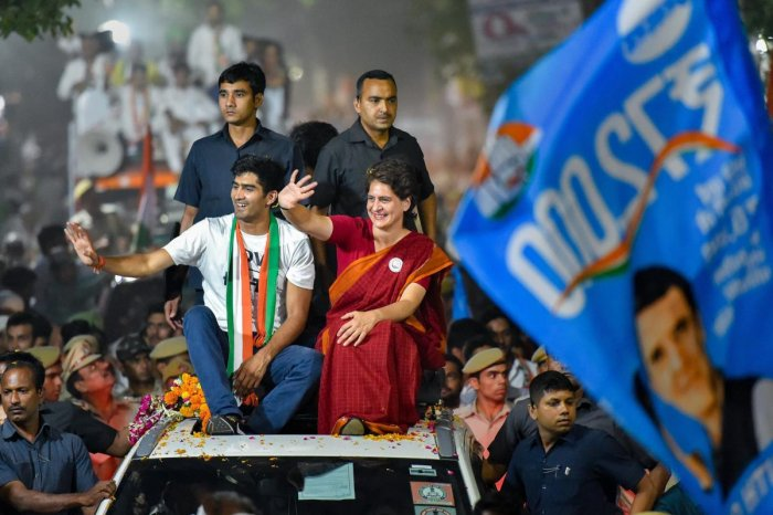 Congress General Secretary Priyanka Gandhi Vadra with party's South Delhi candidate boxer Vijender Singh waves at supporters during an election campaign roadshow for the Lok Sabha polls, in New Delhi. PTI photo