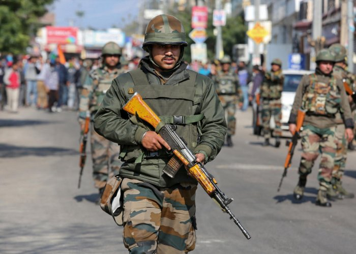 Indian Army soldiers patrol a street. REUTERS
