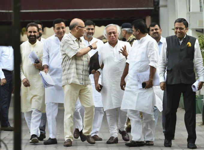 Congress leader Abhishek Manu Singhvi, Jairam Ramesh and Randeep Surjewala and party senior leaders leave after a meeting the Election Commission officials at Nirvachan Sadan, in New Delhi, Friday, April 12, 2019. (PTI Photo)