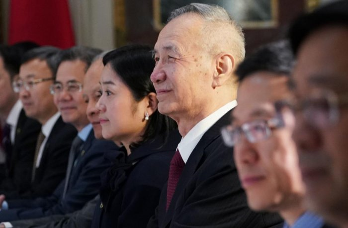 In this file photo taken on February 21, 2019, China's Vice Premier Liu He (3rd R) takes part in US-China trade talks in the Eisenhower Executive Office Building in Washington, DC. AFP
