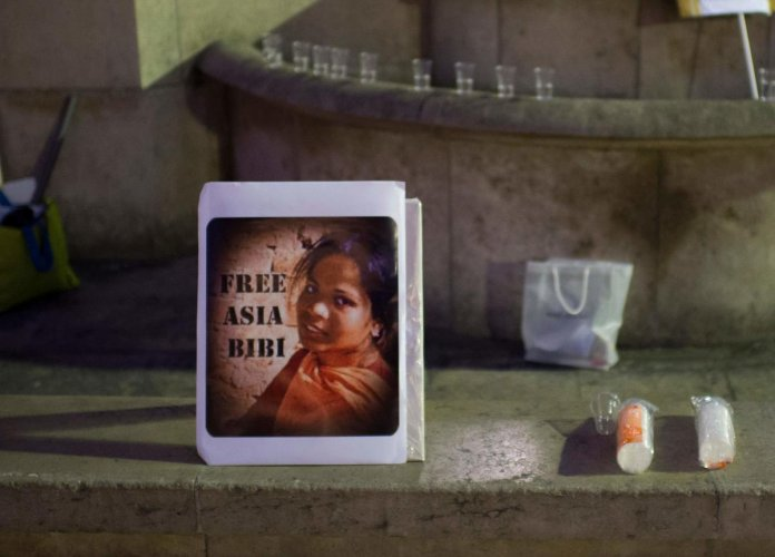 In this file photo taken on October 29, 2014, a portrait of Pakistan's Asia Bibi is displayed during a demonstration to protest against her death sentence in Paris. AFP file photo.