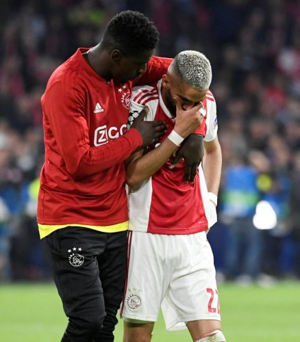 GUTTED: Hakim Ziyech (right) is consoled by a team-mate after Ajax's heartbreaking defeat to Tottenham Hotspur in the second leg of the UEFA Champions League semifinals on Wednesday. Reuters.