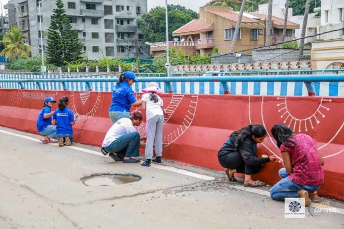Members of Youth For Parivarthan clean up and paint walls on weekends.