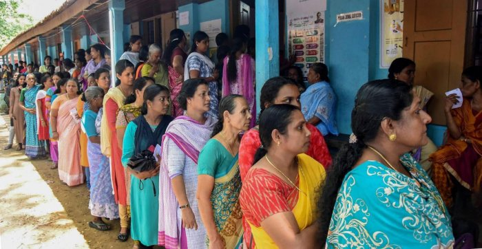 Voters queue up to cast their votes at a polling station, during the third phase of the 2019 Lok Sabha polls, in Kochi, Tuesday, April 23, 2019. (PTI Photo)