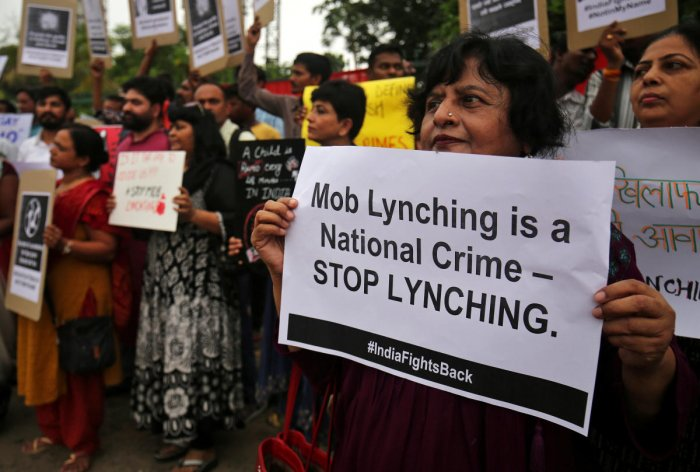 FILE PHOTO: People shout anti-government slogans during a protest against what the demonstrators say are recent mob lynchings across the country, in Ahmedabad, India, July 23, 2018. REUTERS/Amit Dave/File photo
