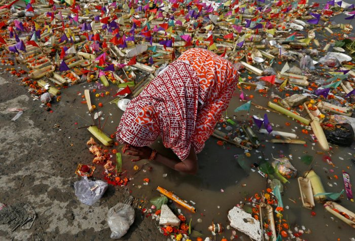 A woman worships in the waters of River Ganga on the occasion of Karthik Purnima. REUTERS