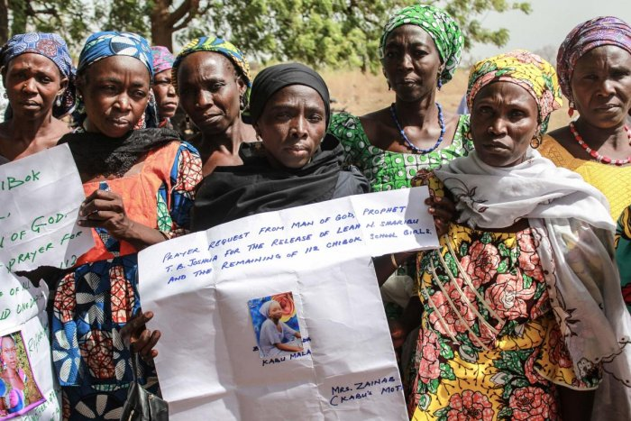 Parents and relatives hold portraits of their girls during a commemoration after they were abducted by Boko Haram Jihadists group. AFP file photo